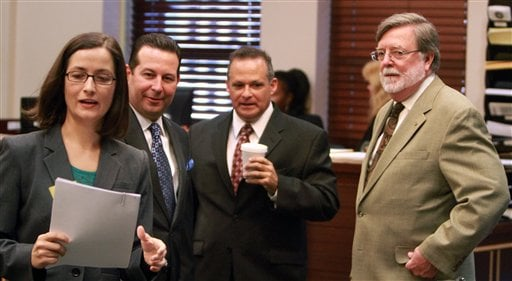 Casey Anthony's defense team, from left, Lisabeth Fryer, Jose Baez and Cheney Mason talk to prosecutor Frank George, second from right, during the hearing at the Orange county courthouse on Friday, Aug. 5, 2011 in Orlando, Fla. (AP)