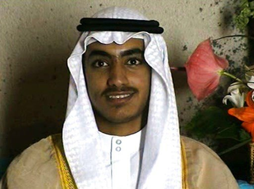 In this image from video released by the CIA, Hamza bin Laden is seen as an adult at his wedding. The one hourlong video shows Hamza bin Laden, sporting a trimmed mustache but no beard, at his wedding. He is sitting on a carpet with other men. (CIA via AP