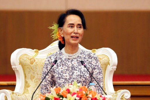 Myanmar's State Counsellor Aung San Suu Kyi smiles and delivers a speech at the ceremony to accept cash donated by private donors for development tasks in Rakhine State at the National Reconciliation and Peace Centre in Naypyitaw, Myanmar, Friday, Oct. 20