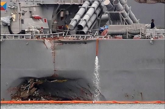 Aug. 22, 2017, file photo, the damaged port aft hull of the USS John S. McCain.