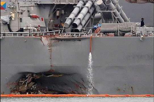 Aug. 22, 2017, file photo, the damaged port aft hull of the USS John S. McCain.
