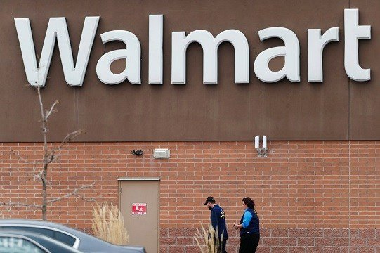 Employees head in to a Walmart store Thursday, Nov. 2, 2017, in Thornton, Colo.