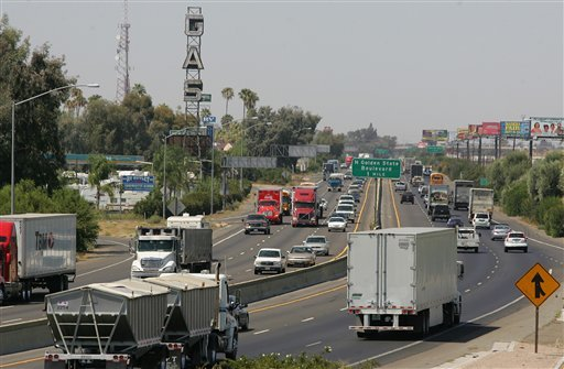 A stretch of the Calif. State Route 99 corridor in the San Joaquin Valley is shown busy with traffic Tuesday, Aug. 23, 2011, in Fresno, Calif.