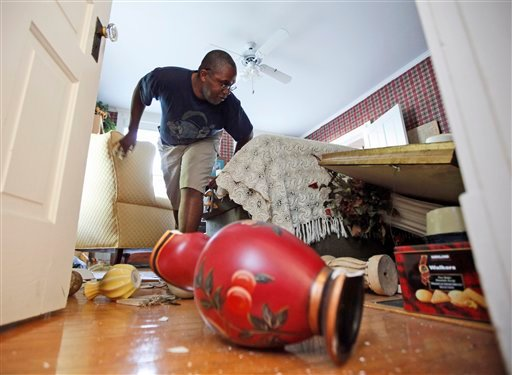 Tony Williams surveys damage at his Mineral, Va. home after an earthquake struck Tuesday, Aug. 23, 2011. (AP Photo/Steve Helber)