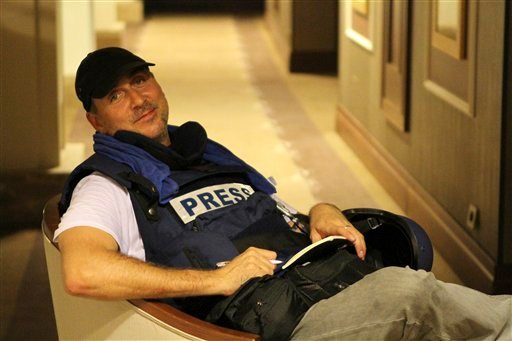 Associated Press photographer Dario Lopez-Mills poses for a photo at the Rixos hotel in Tripoli, Libya Aug. 24, 2011. Lopez-Mills is among dozens of journalists that have been trapped for days in the luxury hotel. (AP Photo/Henry Morton)