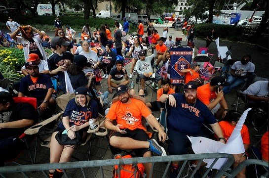 Houston Astros fans gather before a parade honoring the World Series baseball champions.