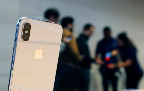 The new Apple iPhone X sits on display as consumers line up to buy the phone at the new Apple Michigan Avenue store along the Chicago River Friday.