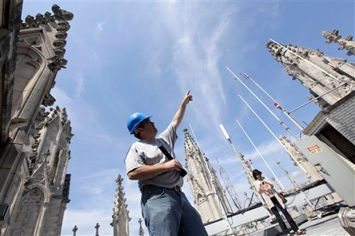Stonemason Sean Callahan examines the damage to the towers of the Washington National Cathedral, in Washington, Wednesday, Aug. 24, 2011, after Tuesday's earthquake.