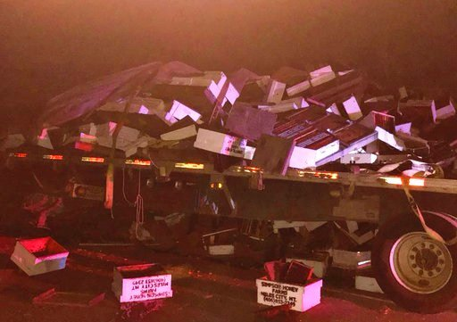 This Thursday, Nov. 2, 2017 photo provided by the Auburn Police Department shows the wreckage of a truck carrying beehives after a crash on Interstate 80 in Auburn, Calif., north of Sacramento in Northern California. (Sgt. Tucker Huey/Auburn Police Depart