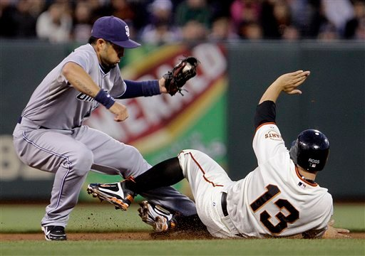 San Francisco Giants' Cody Ross (13) is forced out at second base by San Diego Padres shortstop Jason Bartlett during the second inning of a baseball game Wednesday, Aug. 24, 2011, in San Francisco. Brandon Belt was safe at first. (AP Photo/Ben Margot)