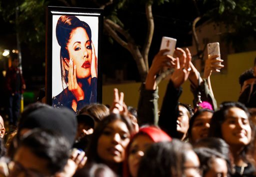 A portrait of the late singer Selena Quintanilla is seen in the crowd following a posthumous star ceremony for Quintanilla on the Hollywood Walk of Fame on Friday, Nov. 3, 2017, in Los Angeles. (Photo by Chris Pizzello/Invision/AP)