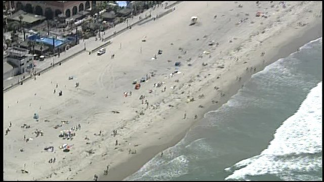 Video screen grab of Mission Beach Thursday, August 25, after a lifeguard reported seeing an 18-inch dorsal fin. (Courtesy Chopper 8)