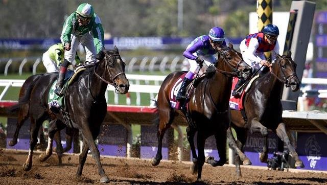 Irad Ortiz, Jr., left, rides Bar of Gold to victory in the Filly & Mare Sprint horse race during the Breeders' Cup, Saturday, Nov. 4, 2017, in Del Mar, Calif. (AP Photo/Denis Poroy)