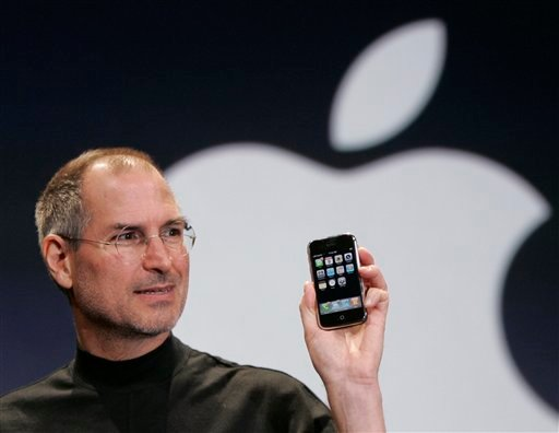 FILE - In this Jan. 9, 2007 file phtoo, Apple CEO Steve Jobs holds up an Apple iPhone at the MacWorld Conference in San Francisco.