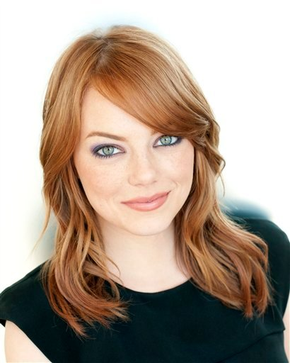 """FILE - In this July 22, 2011 file photo, actress Emma Stone poses for a portrait at Comic Con in San Diego, Calif. Stone will stars in the upcoming film, """"The Help,"""" based on the book by Kathryn Stockett. (AP Photo/Dan Steinberg, file)"""