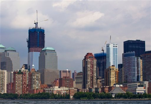 One World Trade Center rises above neighboring buildings in Lower Manhattan, as seen from New York harbor Friday, Aug. 26, 2011.