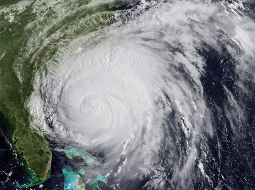 This satellite image provided by NOAA and taken at 12:45 GMT Friday Aug. 26, 2011 shows Hurricane Irene as it moves northward along the U.S. eastern coastline with 110 mph sustained winds.