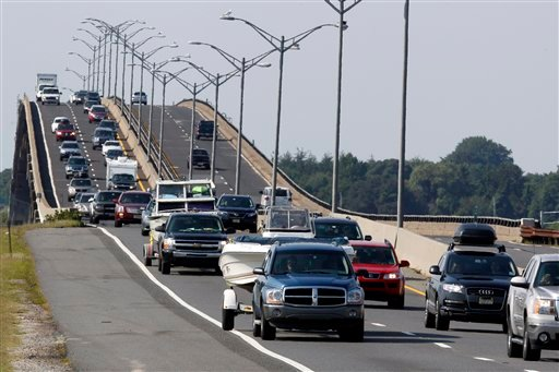 Sport utility vehicles pulling pleasure boats drive in lines of traffic headed north on the Garden State Parkway across the Great Egg Harbor Bay Inlet Bridge, Friday, Aug. 26, 2011, near Ocean City, N.J.
