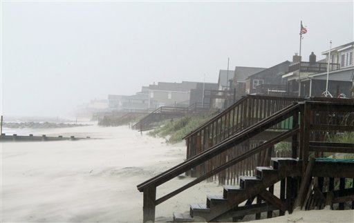 Heavy rains and wind from Hurricane Irene whip the sand on the beach at Pawleys Island, S.C., Friday, Aug. 26, 2011.