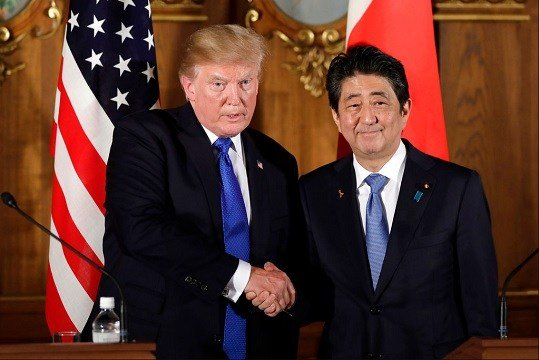 President Donald Trump, left, shakes hands with Japanese Prime Minister Shinzo Abe during a joint news conference at the Akasaka Palace.
