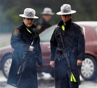 Pennsylvania State Police troopers man a roadblock Sunday, Aug. 28, 2011, in Furlong, Pa. A soldier who recently returned from war service fired at officers in suburban Philadelphia as he was sought in four Virginia deaths. (AP)