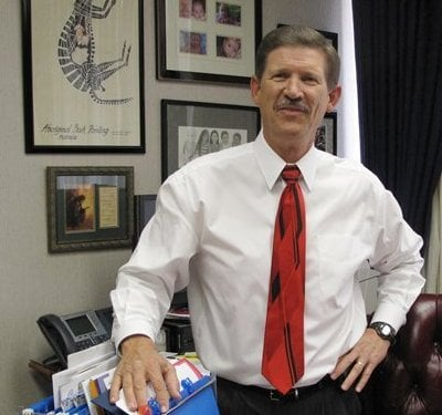 In this Friday Aug. 26, 2011 photo, Fresno County School Superintendent Larry Powell poses for a photo in his office, in Fresno, Calif. (AP)
