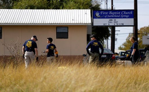 Law enforcement officials investigate the scene of a shooting at the First Baptist Church of Sutherland Springs, Monday, Nov. 6, 2017, in Sutherland Springs, Texas. A man opened fire inside the church in the small South Texas community on Sunday, killing
