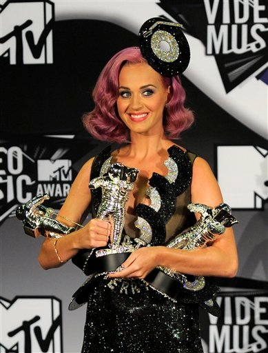 Katy Perry poses with her awards backstage at the MTV Video Music Awards on Sunday Aug. 28, 2011, in Los Angeles.(AP Photo/Chris Pizzello)