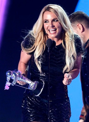 """Britney Spears accepts the award for best pop video for """"Till The World Ends"""" at the MTV Video Music Awards on Sunday Aug. 28, 2011, in Los Angeles. (AP Photo/Matt Sayles)"""