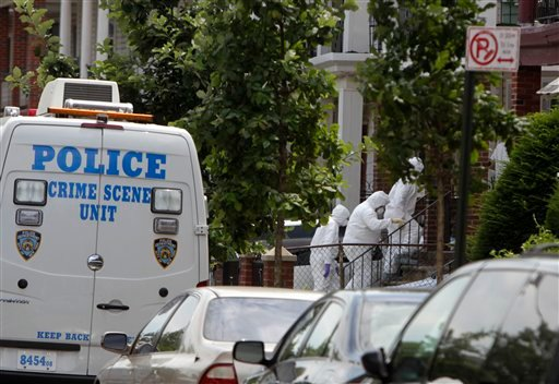 FILE - In this July 13, 2011 file photo, people in protective clothing enter the house where suspect Levi Aron was apprehended in connection to the murder of a missing boy in the Brooklyn borough of New York.