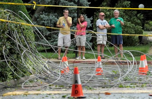 FILE - In this file photo taken Aug. 28, 2011, residents of Annapolis, Md., look at downed power lines after Hurricane Irene.