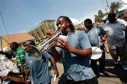 A member of the Big 9 marching club plays trumpet in a second line commemorating the sixth anniversary of Hurricane Katrina in New Orleans, Monday, Aug. 29, 2011.