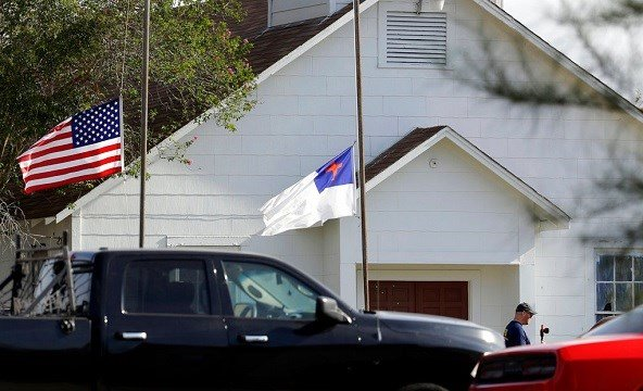 Flags fly at half-staff as law enforcement officials continue to investigate the scene of a shooting at the First Baptist Church of Sutherland Springs.