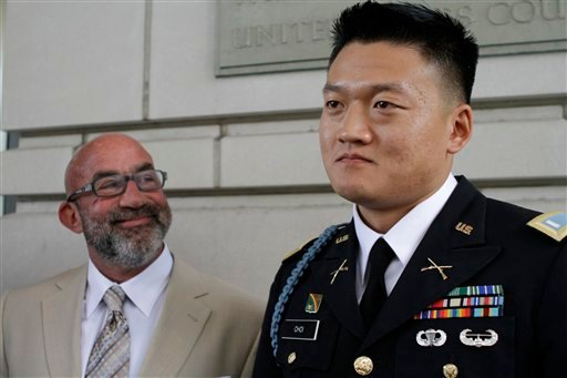 """Former Army Lt. Dan Choi, right, an openly gay Iraq war veteran who protested the military's """"don't ask, don't tell"""" policy by handcuffing himself to a White House fence, speaks to the media with his lawyer, Robert Feldman."""