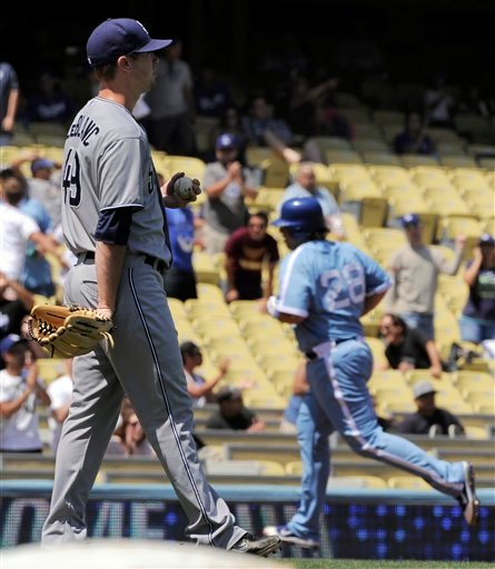 San Diego Padres starting pitcher Wade LeBlanc, left, looks on as Los Angeles Dodgers' Rod Barajas rounds third after hitting a two-run home run in the second inning of their baseball game, Wednesday, Aug. 31, 2011, in Los Angeles.