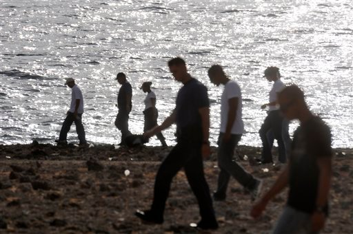 Volunteers from the Red Cross, Police Academy and Fire Department search for the remains of missing American woman Robyn Gardner in the eastern coast of Aruba, Monday Aug. 22, 2011.