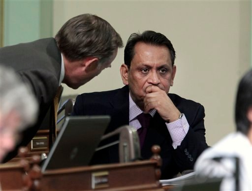Assemblyman Jared Huffman, D-San Rafael, left, talks with Assembly member Gil Cedillo, D-Los Angeles, at the Capitol in Sacramento, Calif. Wednesday, Aug. 31, 2011.
