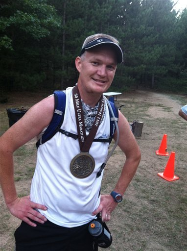 In this photo taken Aug. 27, 2011, Brandon Mulnix is shown after the North Country Run in Manistee, Mich. Mulnix, of Lowell, says he consumed only liquid nutrition while running for more than 12 hours in the 50 mile race.