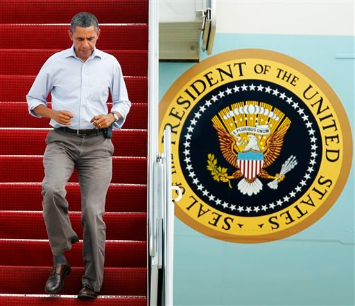 President Barack Obama jogs down the ramp of Air force One as he arrives at Andrews Air Force Base, Md., after a trip to New Jersey to tour Hurricane Irene damage, Sunday, Sept. 4, 2011. (AP Photo/Manuel Balce Ceneta)