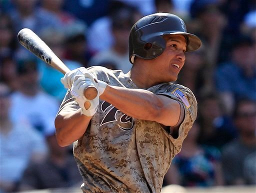 San Diego Padres' Will Venable follows the flight of his bases load triple against the Colorado Rockies during the eighth inning of a baseball game Sunday, Sept. 4, 2011 in San Diego. (AP Photo/Lenny Ignelzi)
