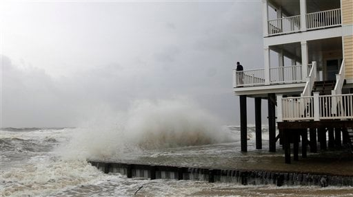Squalls and heavy surf pounds homes along the beach in Dauphin Island, Ala., Monday, Sept. 5, 2011. (AP Photo/Dave Martin)