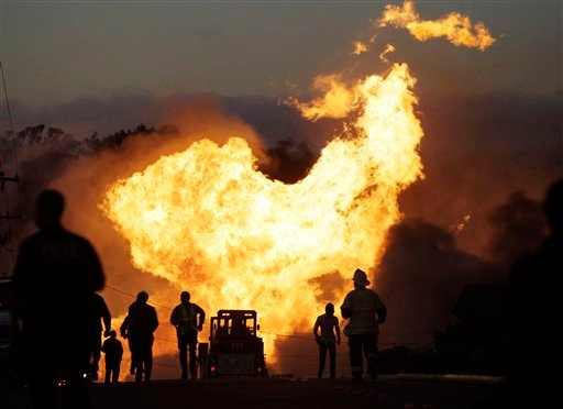 In this Sept. 9, 2010 file photo, a massive fire roars through a mostly residential neighborhood in San Bruno, Calif. A year after the explosion, the neighborhood and survivors of the tragedy are still struggling to rebuild. (AP Photo/Paul Sakuma, File)