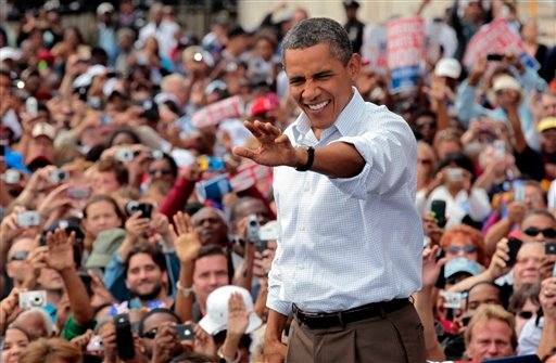 President Barack Obama waves to supporters during a Labor Day speech at Detroit's Renaissance Center, headquarters of General Motors, Monday, Sept., 5, 2011, in Detroit, Mich. (AP Photo/Pablo Martinez Monsivais)