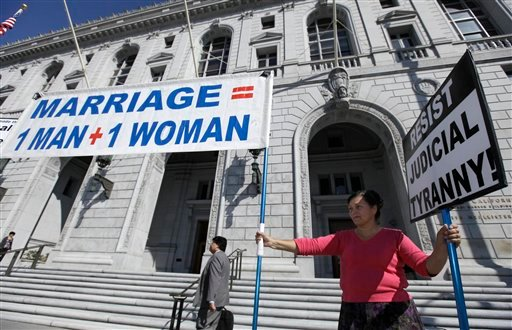 Natalya Choban of Sacramento, Calif., protests against gay marriage outside a courtroom where the California Supreme Court was hearing arguments in San Francisco, Tuesday, Sept. 6, 2011.