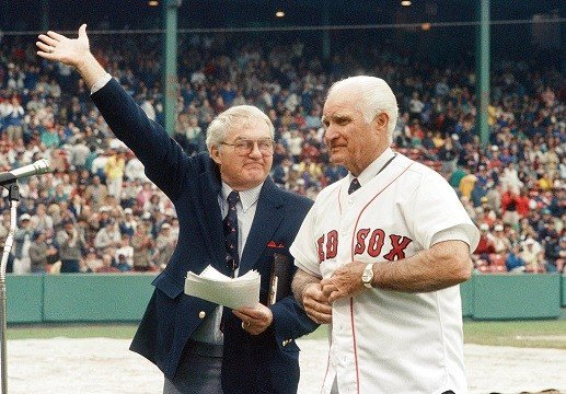 Boston Red Sox, Kent Coleman, left, presents former Red Sox second baseman Bobby Doerr to the crowd at Fenway Park.