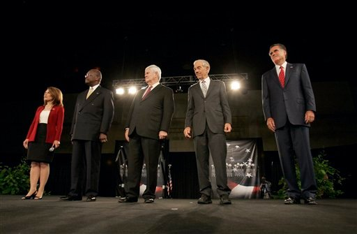 Republican presidential candidates, from left, Rep. Michele Bachmann, R-Minn., businessman Herman Cain, former Rep. Newt Gingrich, Rep. Ron Paul, R-Texas, and former Massachusetts Gov. Mitt Romney stand together. (AP Photo/ Mary Ann Chastain)