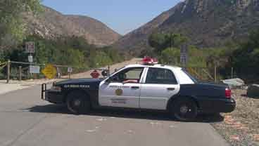 Picture taken at Mission Trails Park Wednesday, September 7, 2011, as a police officer blocks the start of a trail, after a body is found. Picture courtesy of @PriceCBS8.