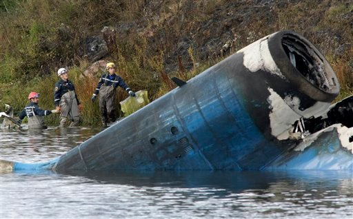 Rescuers work at the crash site of a Russian Yak-42 jet near the city of Yaroslavl, on the Volga River about 150 miles (240 kilometers) northeast of Moscow, Russia, Wednesday, Sept. 7, 2011.