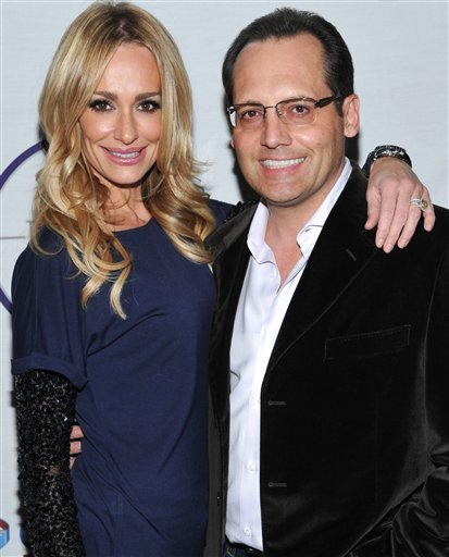 FILE - In this Feb. 5, 2011 file photo, television personality Taylor Armstrong, left, and husband Russell Armstrong attend a Super Bowl party in Dallas, Texas.