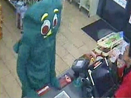 In this surveillance video taken Sept. 5, 2011 and released by the San Diego Police Department showing a suspect dressed like Gumby telling a convenience store clerk he is being robbed, fumbling inside the costume as if to pull a gun.